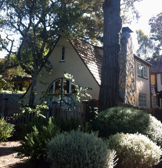 A house that makes you feel as if you lived in the woods. Look at the arched main window and the rock made chimney.